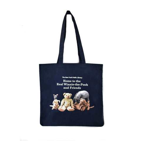 "Illustration of Winnie the Pooh and Friends in navy blue background tote. Text on top of image reads ""The New York Public Library. Home to the real Winnie the Pooh and friends"""