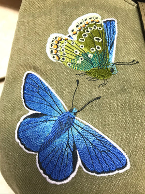 Blue Butterfly on Green Denim Cottagecore Hobo embroidery close-up view