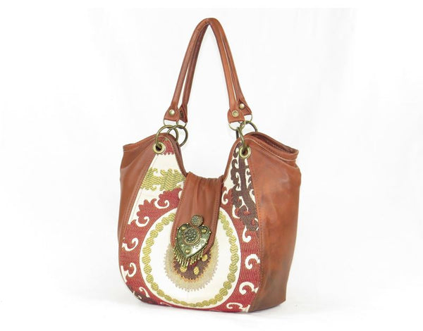 Caramel Leather and Mandala Tapestry Bucket Bag handles up