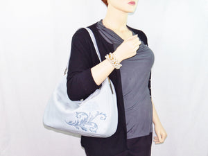 Embroidered Gray Leather Slouchy Hobo Handbag model view