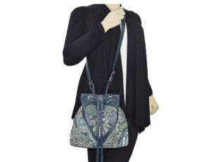 Embroidered Navy Blue Leather and Paisley Tapestry Bucket Bag modeled