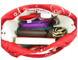 Ivory Leather and Red Tapestry Bucket Bag interior contents