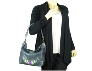 Pansies on Slate Blue Slouchy Hobo Leather Bag model view