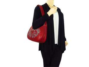 Red Leather Skulls Embroidered Hobo Handbag model view