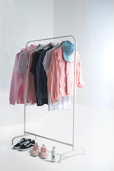 Dressing rail of neat clothes with Liquiproof bottle