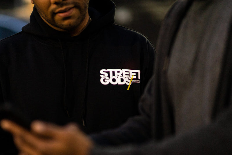 Car club owner Q&A Manolo Cruz of Mpireboyz wearing Street Gods black hoodie