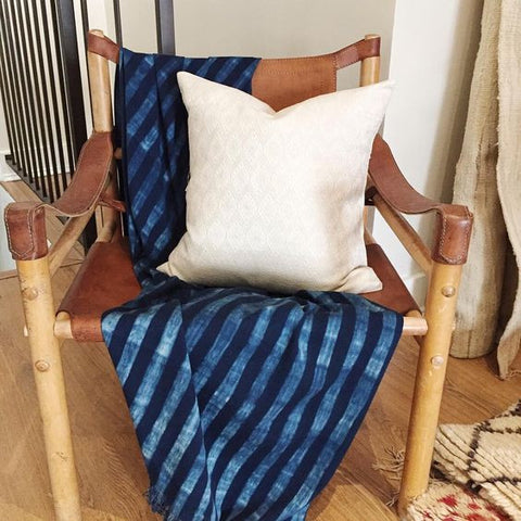 Indigo throw draped over safari chair with pillow - Clover