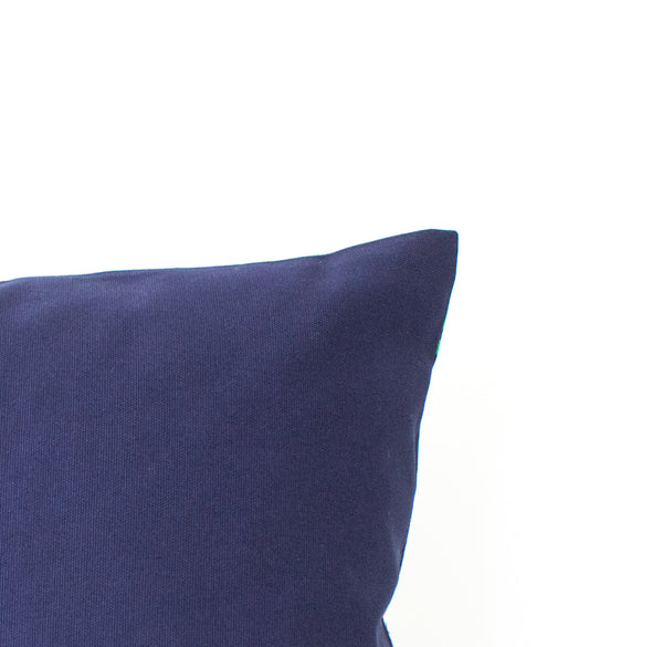Detail of back side of pillow in navy cotton.