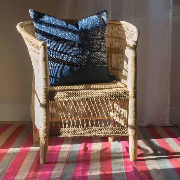 Frazada as rug under rattan Malawi chair