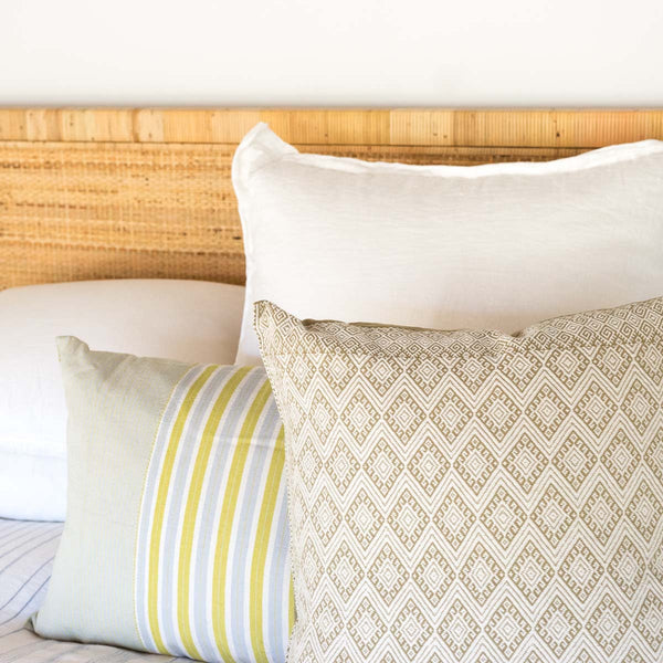 Mexican pillows styled on bed