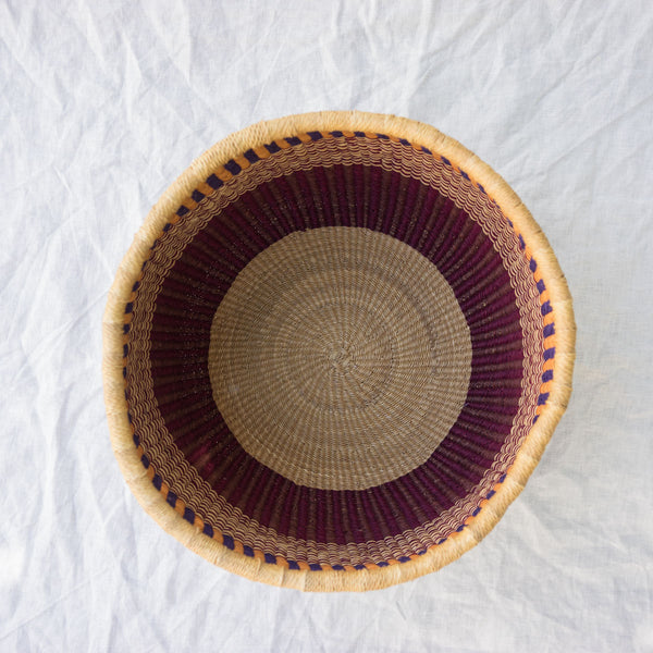 Overhead view of African Basket I in pink, navy blue & natural
