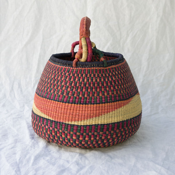 Side view of African Pot Basket I - pink & navy blue