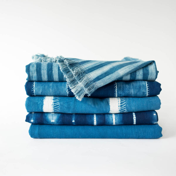 Stack of Tensira indigo throws