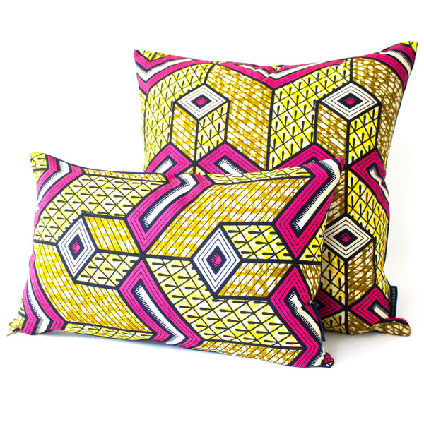 Square and rectangular throw pillows in African wax fabric.
