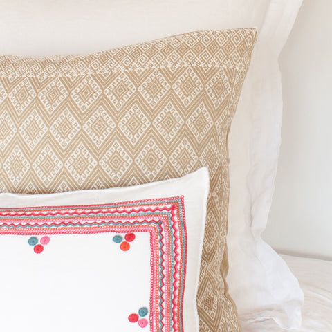 Chiapas Embroidered Pillow I from El Camino de Los Altos styled on bed