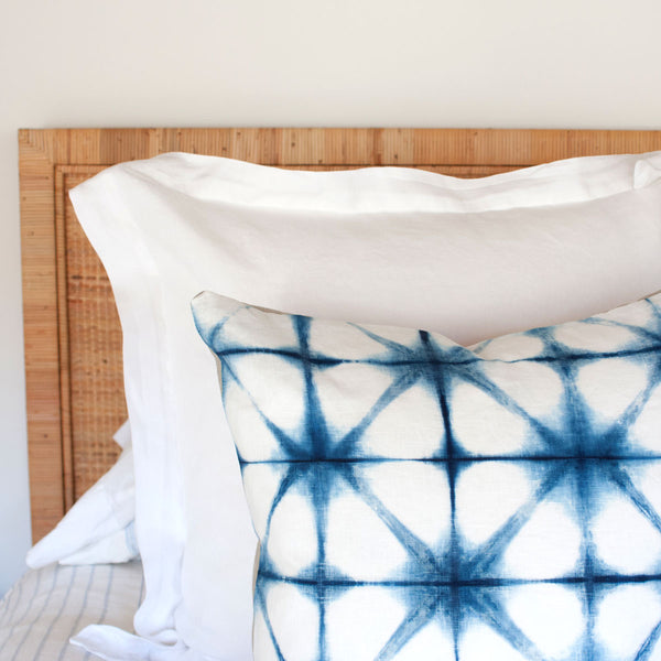 Close up of Shibori Pillow IV on bed