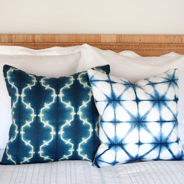 Shibori Pillows V and IV on bed