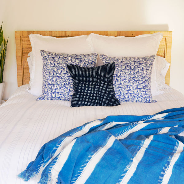 African indigo pillow styled on bed