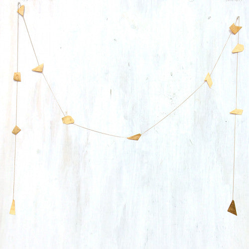| organic garland | an organic forged brass garland, perfect for the mantle, wall, or tree | hand cut and hammered brass on vintage brass chain | #failjewelry