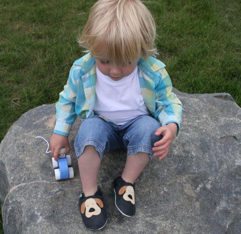 Felix park photo wearing Dinosaur first toddler baby shoes