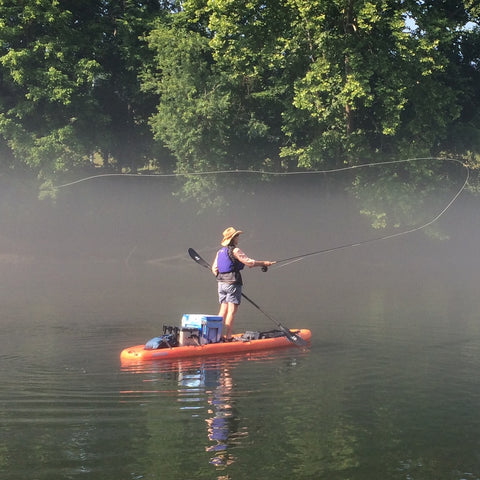 Canoe with Susan Thrasher Fly Fishing on a river