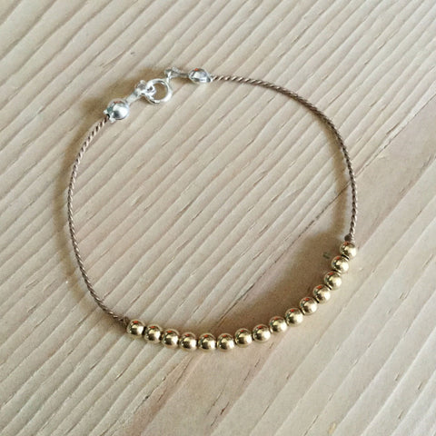 14k gold-filled bead thread bracelet