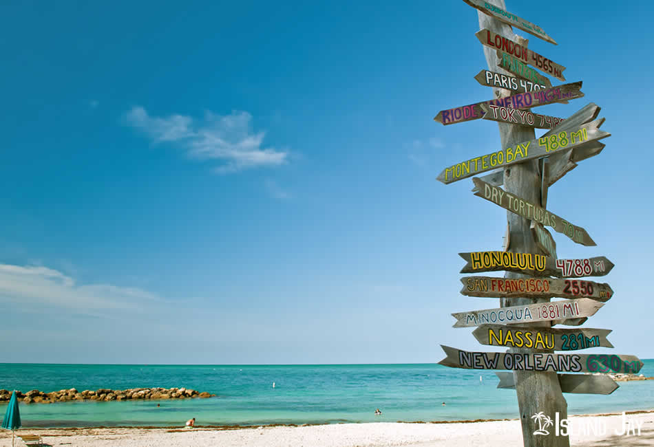 A direction sign at the Beach