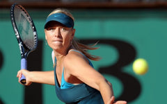 Maria Sharapova's visor is nice, but does not shade her face because the brim is too short