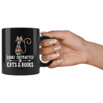 """Cats and books""11oz black mug"