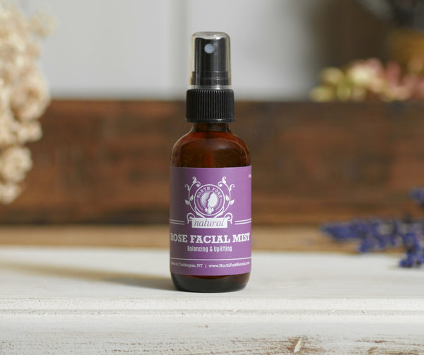 image representing natural organic facial toner in spray bottle with rose essential oil