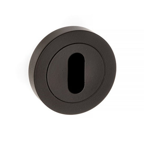 Atlantic Handles Forme Key Escutcheon on Contempo Round Rose in a Matt Black Finish - MODA Doors