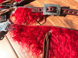 Red angora on dark oil