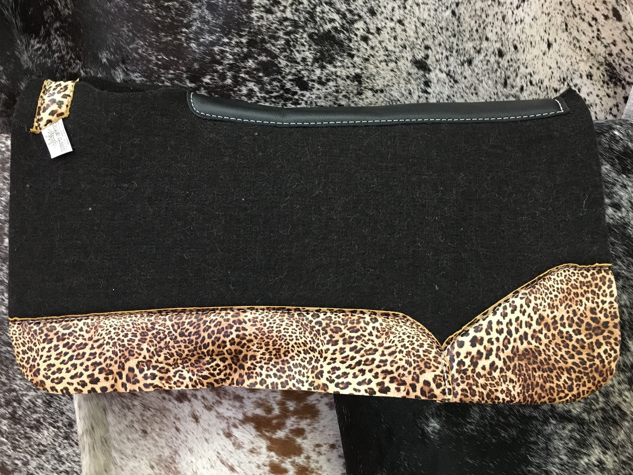 Best ever saddle pad with cheetah wear leathers
