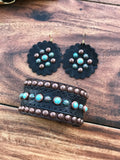 Black elephant with turquoise rocks