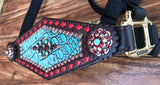 Turquoise gator with red buckstitch