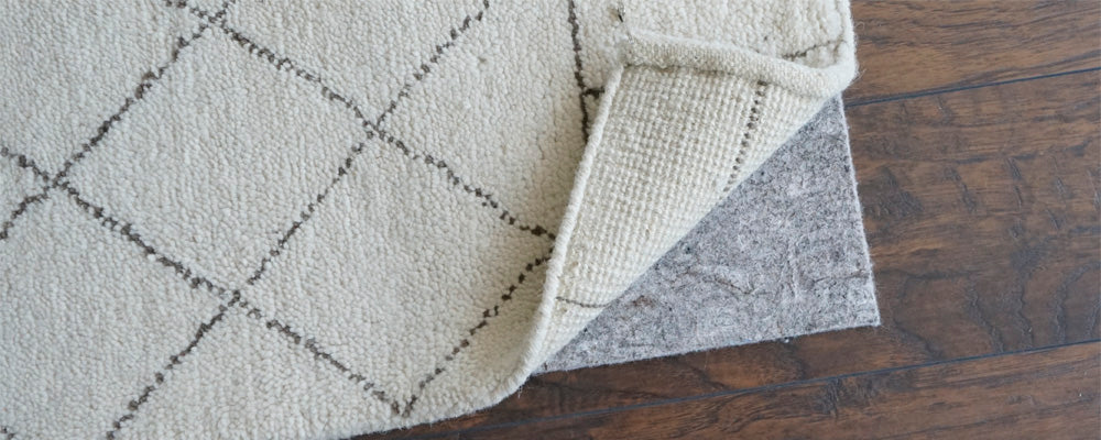 Why wool rugs need pads (and why size matters)