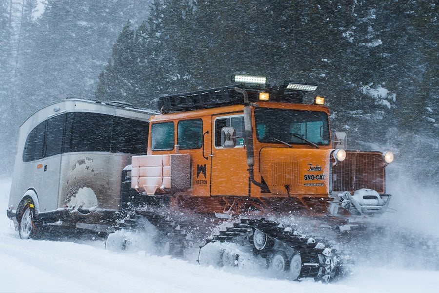Weston Snowboards' Tucker Snowcat pulling an Airstream Basecamp