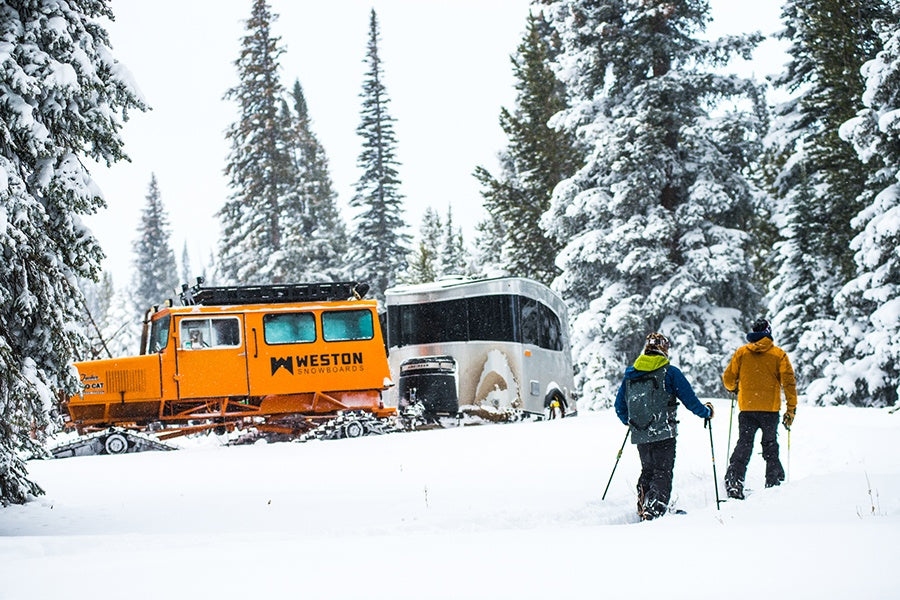 Weston Snowboard owners splitboarding up to Tucker Snowcat and Airstream Basecamp