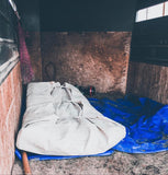 J bar D Canvas Bedroll laid out in a barn ready to be slept in.