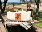 Our Rodeo Garrett bags are constructed from our heavy 15 ounce canvas, two end pockets, a stout brass zipper, leather gripper, with snaps, on the handles. A leather shoulder strap, which can be personalized.