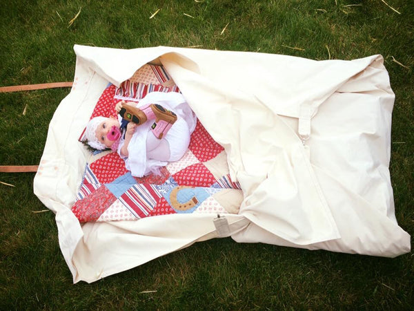 Our canvas baby bedroll measures 8'x5' and is built from our 10.10 oz. Army Duck Canvas. It is a replica of our original adult bedroll.