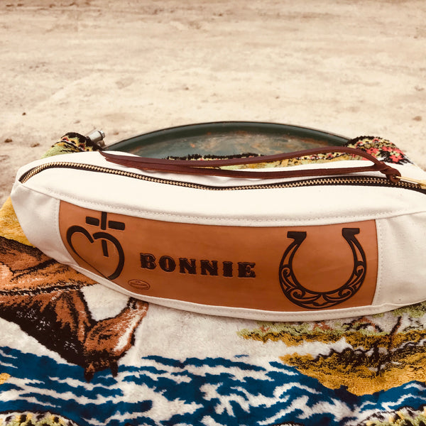 This Canvas and Leather Cantle Bag sits nicely on the back of your saddle, with a custom designed leather patch. Otherwise known as medicine bags or saddle bags.