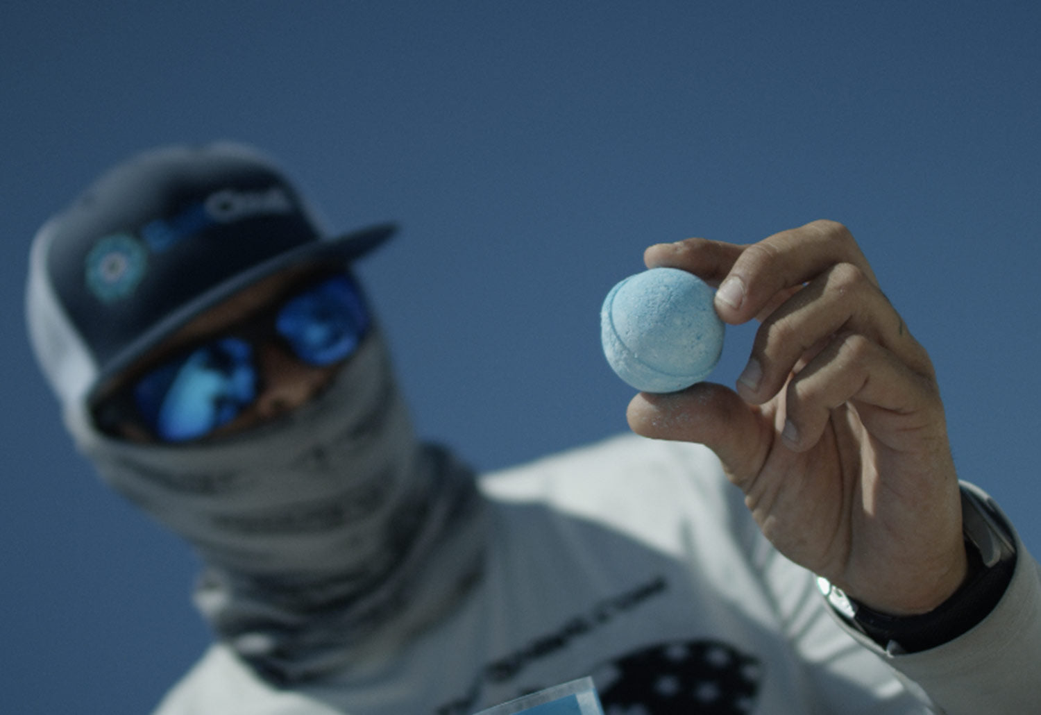 Angler holds a BaitCloud ball getting ready to throw it into the water.