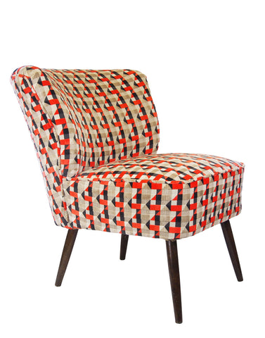 The Bartholomew Chair in Neon Orange Piccadilly Velvet