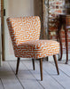 The New Genovesa Cocktail Chair in Christopher Farr Orange Meander available at GalapagosDesigns.com