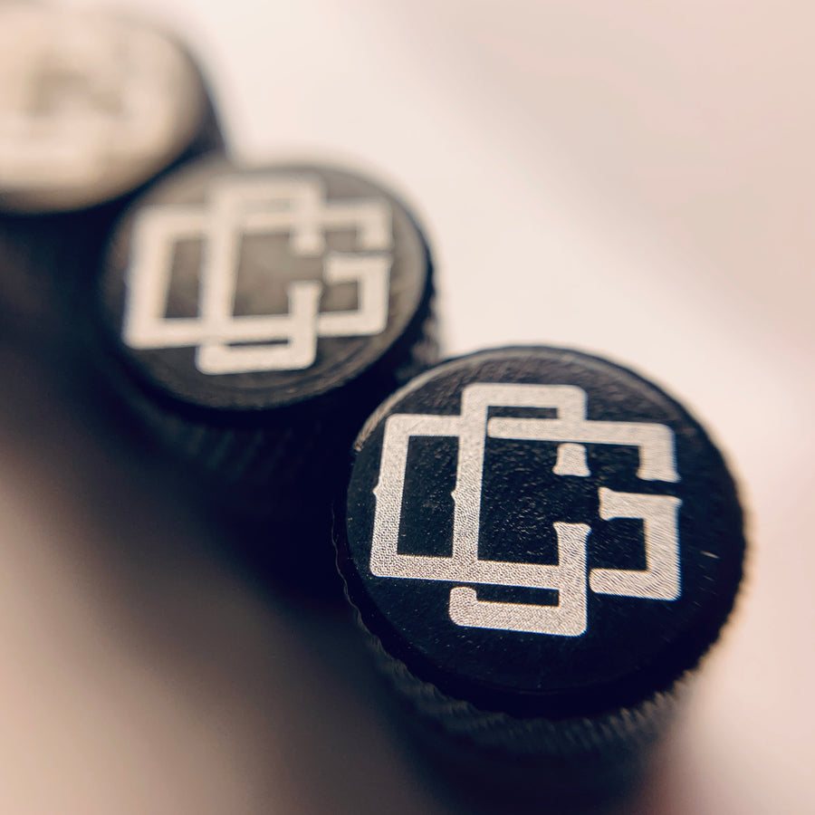 CG MONOGRAM VALVE STEM CAPS