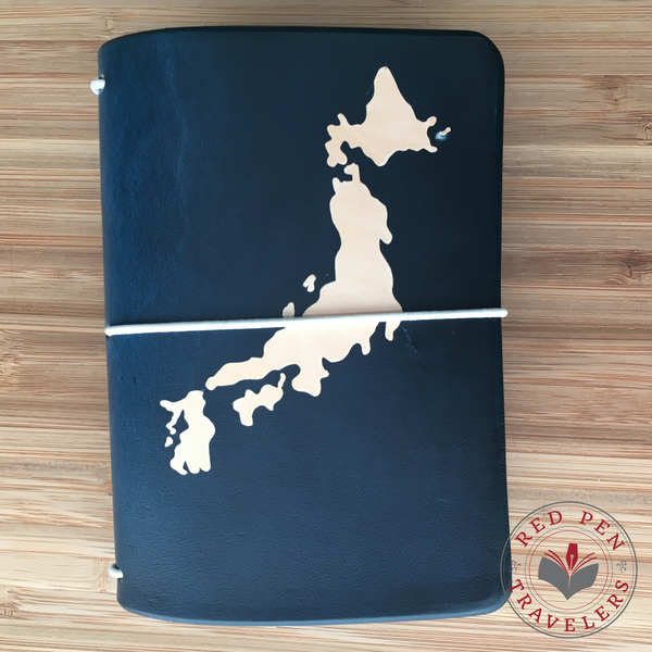 Midnight travelers notebook with the shape of Japan dyed into the cover.