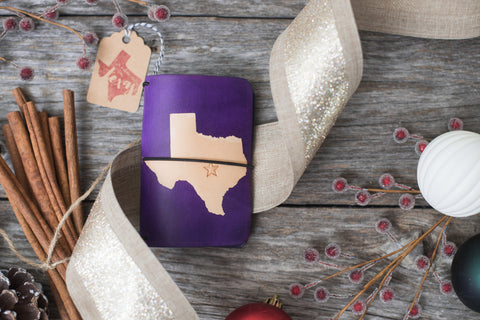 Purple travelers notebook with the shape of Texas dyed into the front cover.