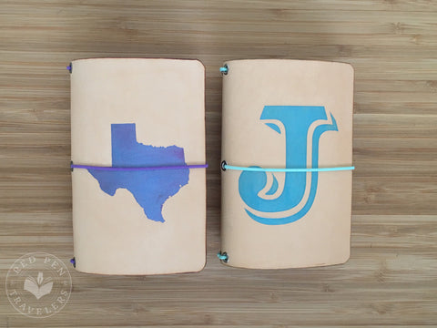 "Midnight shape of Texas on an undyed notebook; large turquoise ""J"" on an undyed notebook."