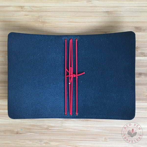 Inside view of midnight travelers notebook with cardinal elastic.